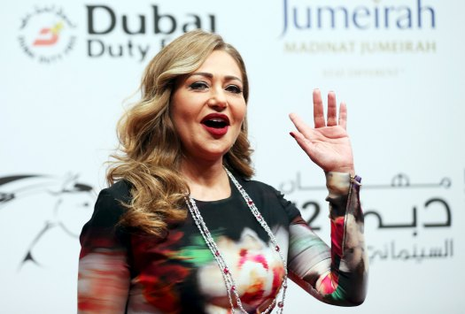 Egyptian actress Laila Alawi waves during the opening of the 12th Dubai international film festival, in Dubai